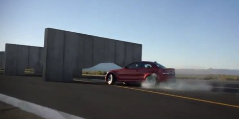 Video: BMW 1 M Coupe drives through cement walls