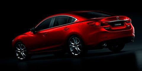 2013-Mazda6-static-dark-rear.jpg