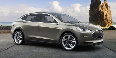 Tesla, car makers' alliance pushing to legalise side cameras