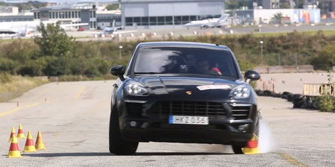 Porsche Macan locks up, skids during moose test