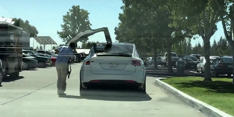Tesla Model X falcon wing doors filmed in action before debut