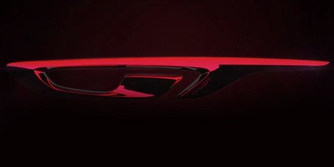 Opel GT coupe teased ahead of Geneva debut - video