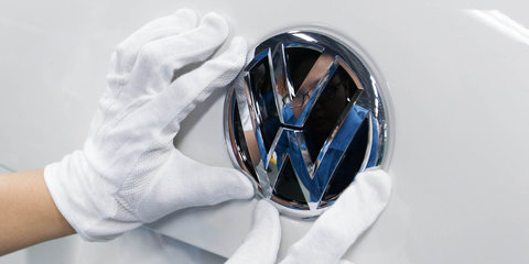Volkswagen AG details plan for cleaner future, as shareholder meeting turns acrimonious