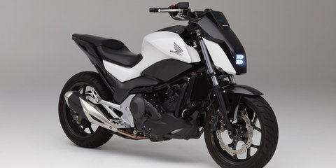 Honda demonstrates self-balancing bike, improved voice recognition technology