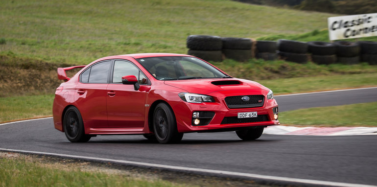 2016-ford-focus-rs-subaru-wrx-sti-volkswagen-golf-r-track-test-55