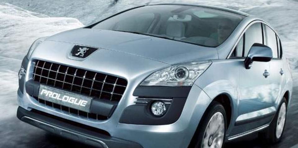 Peugeot-Citroen to delay plug-in hybrids