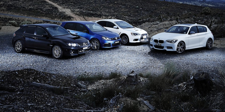 Sports car comparison: BMW M135i v Mitsubishi Lancer Evolution v Subaru WRX STI v Volkswagen Golf R