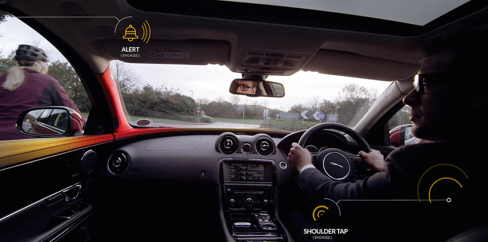 Jaguar Land Rover trialling safety system that taps drivers on the shoulder to warn of cyclists