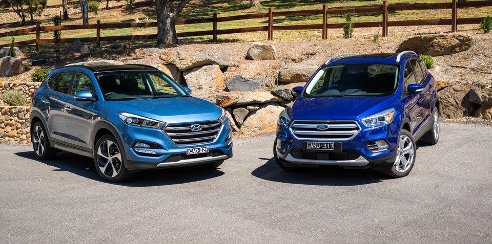 Hyundai Tucson Highlander v Ford Escape Titanium petrol SUV comparison