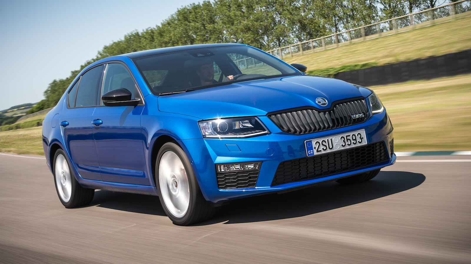 skoda octavia rs sporty sedan wagon here in 2014 photos 1 of 19. Black Bedroom Furniture Sets. Home Design Ideas