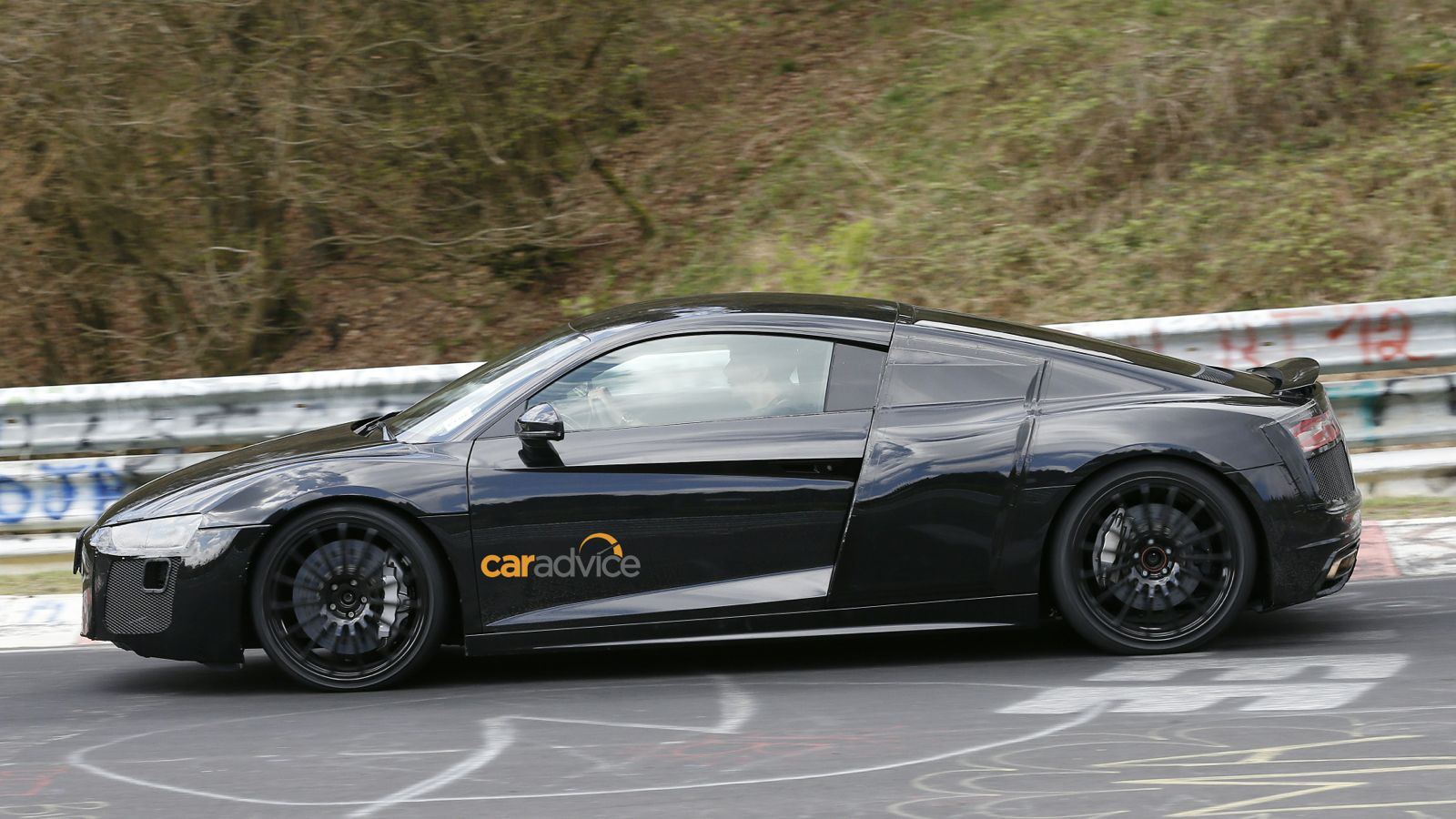 2015 Audi R8 Spied With Less Camouflage Photos 1 Of 19