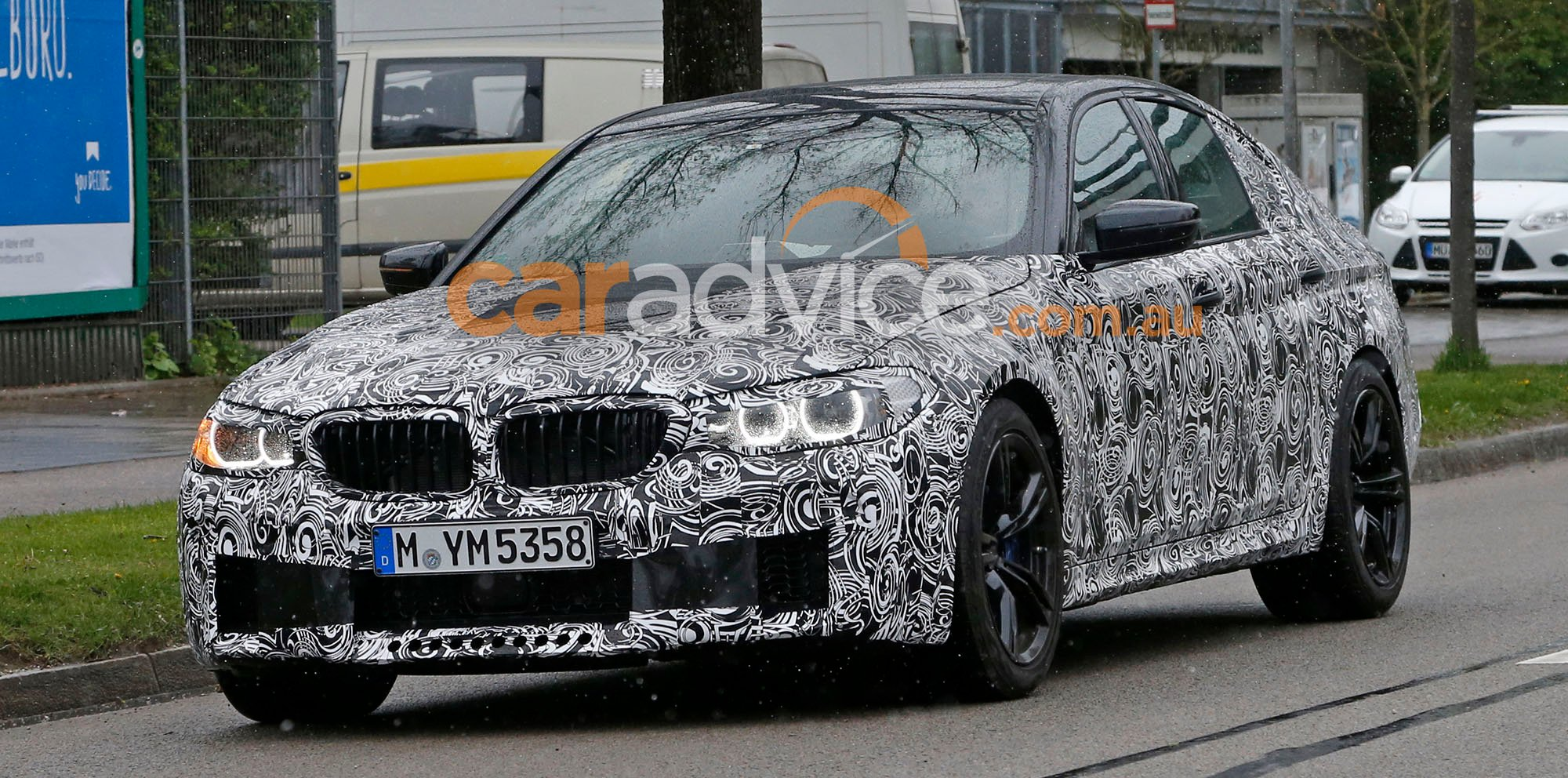 Bmw m5 sedan and 5 series wagon spied with less camouflage