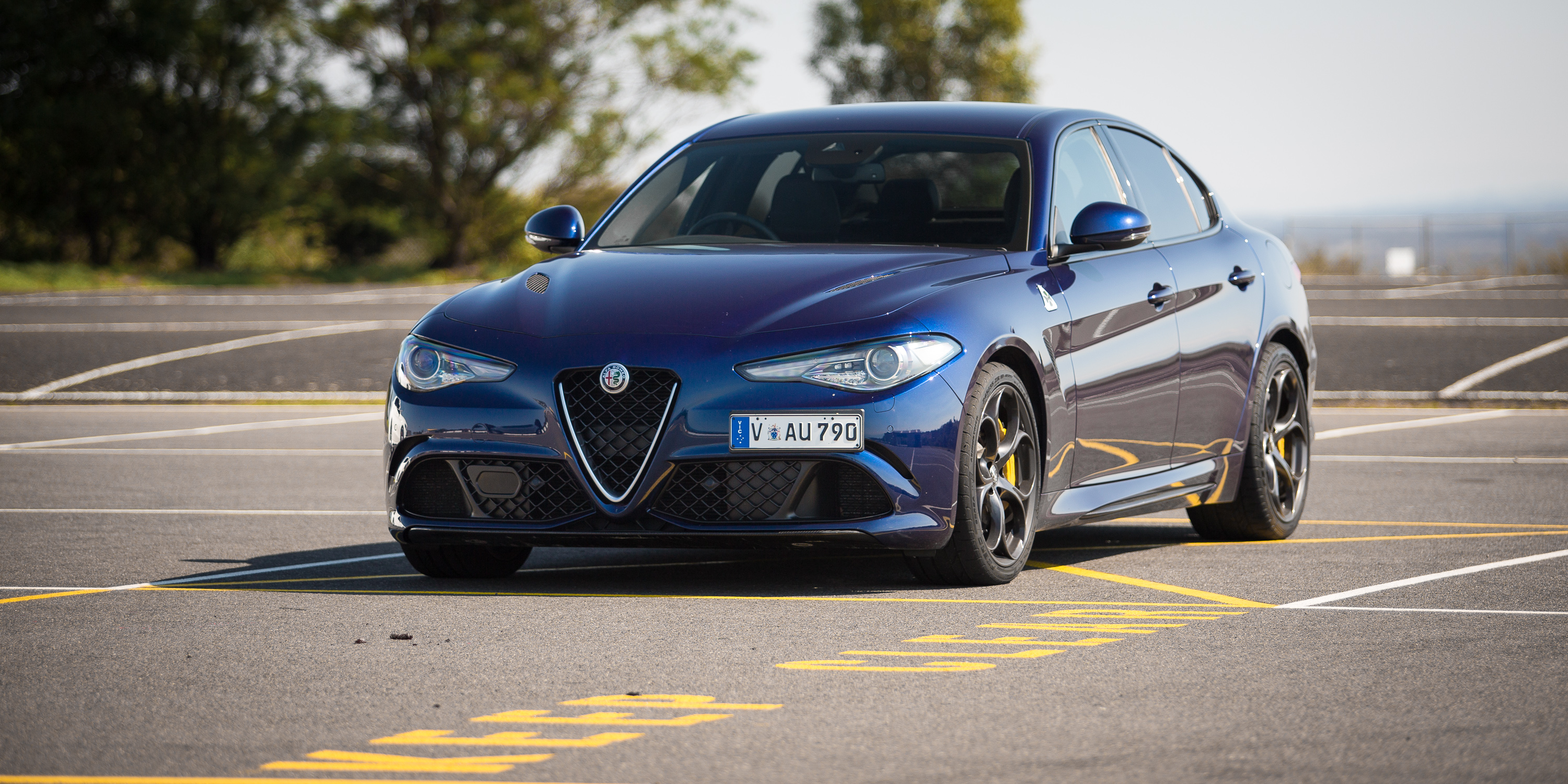 Alfa romeo giulia qv v bmw m3 competition v mercedes amg for Alfa romeo vs mercedes benz
