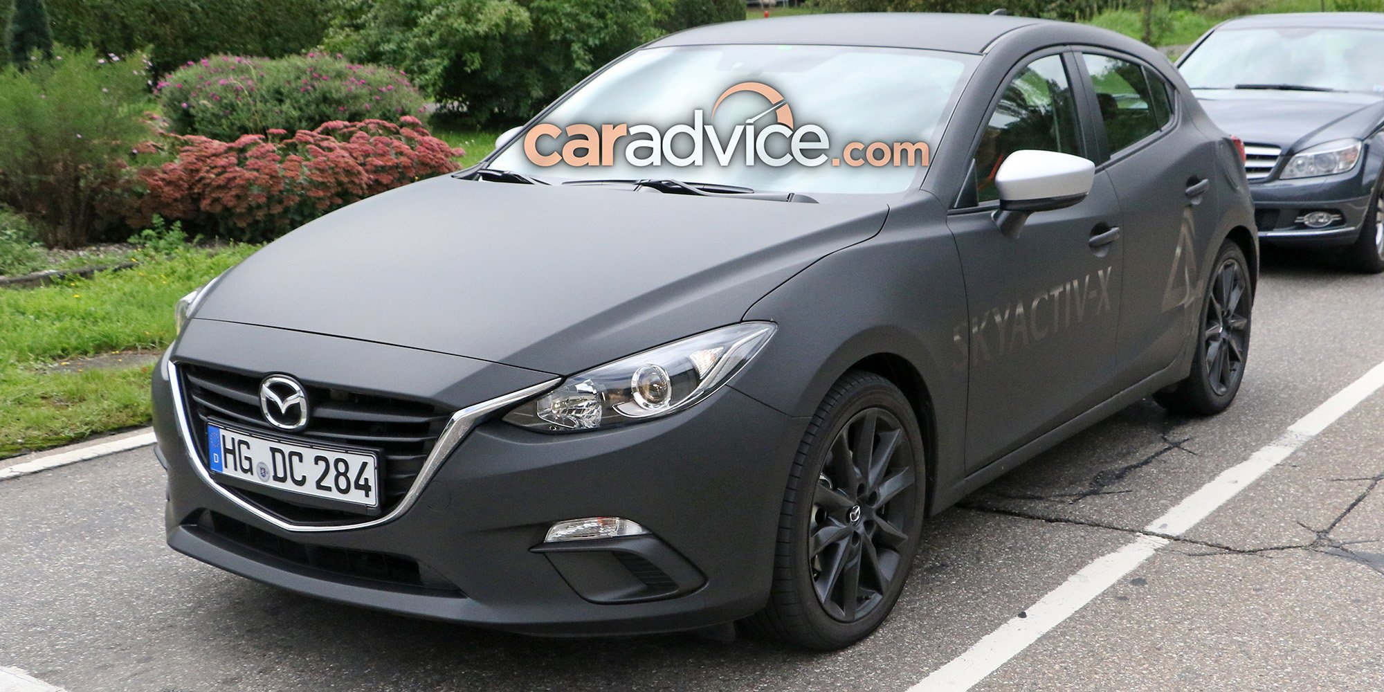 2019 mazda 3 spied with skyactiv x engine photos 1 of 9. Black Bedroom Furniture Sets. Home Design Ideas