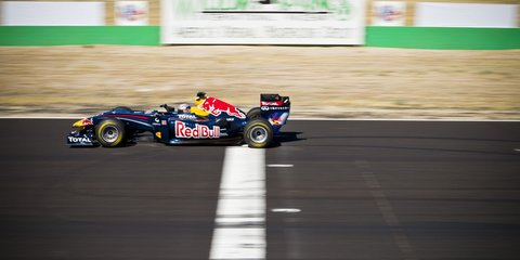 Tom Cruise drives Red Bull F1 race car