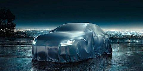 2015 Volkswagen Passat takes shape under cloak