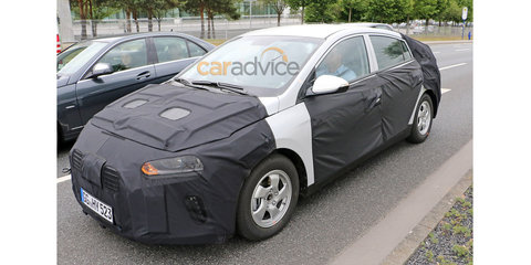 Hyundai Prius competitor spied inside and out