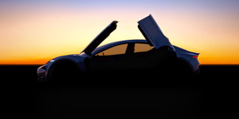 Fisker previews new model with 'butterfly doors'