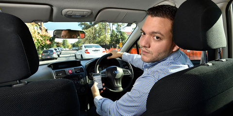 Hands-free phone users drive more cautiously - study