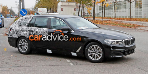 2017 BMW 5 Series Touring spied with lightweight camouflage