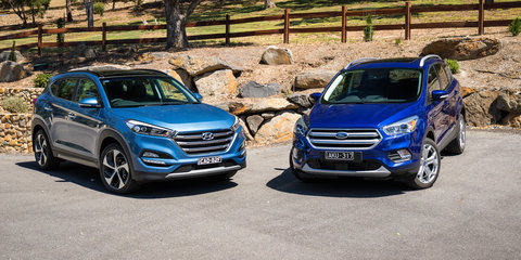 Hyundai Tucson Highlander v Ford Escape Titanium petrol SUV comparison