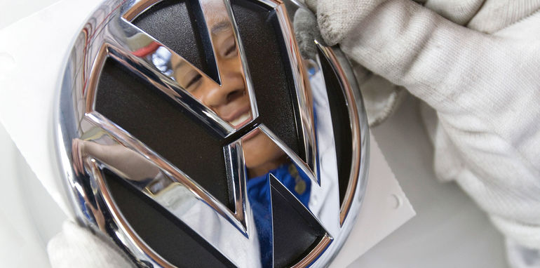 Volkswagen badge being affixed at Uitenhage plant in South Africa
