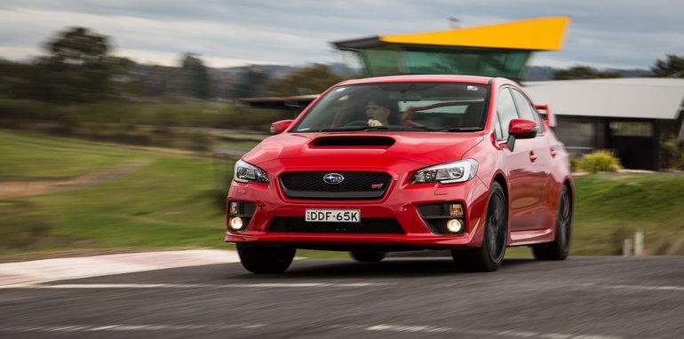 2016-ford-focus-rs-subaru-wrx-sti-volkswagen-golf-r-track-test-16