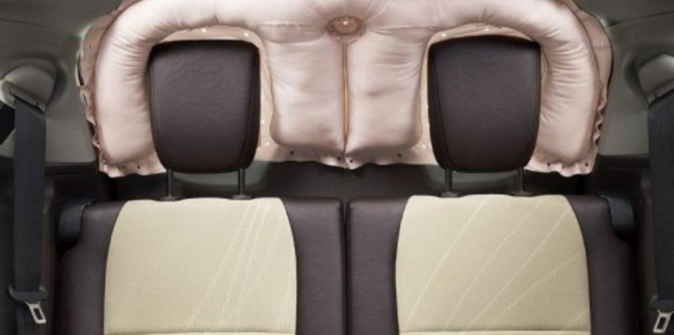 Toyota develops rear window curtain shield airbag