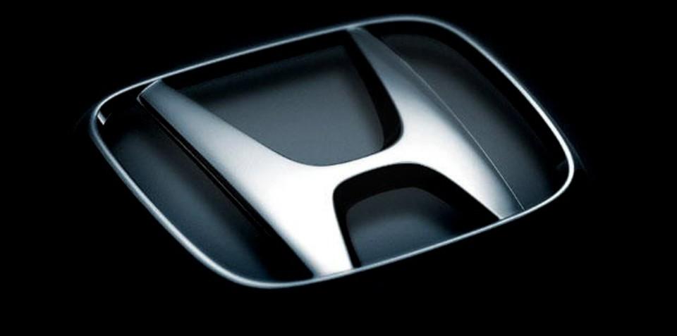 Honda cuts profit outlook as sales plunge