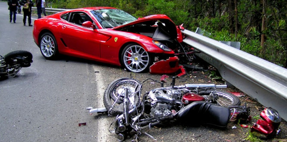 Ferrari 599 driver crashes into motorbike riders and keeps licence