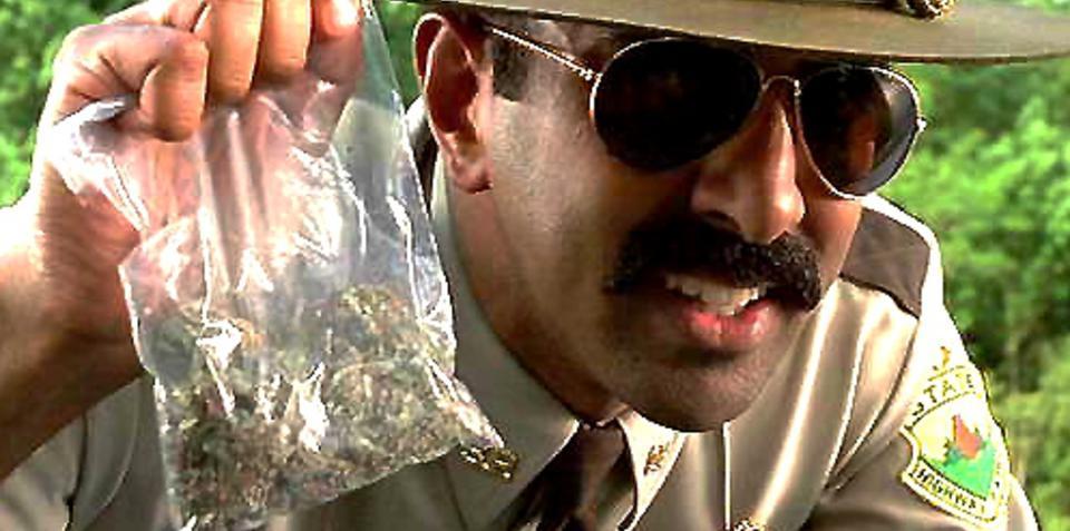 Stoner lands bag of pot on the bonnet of policeman's car