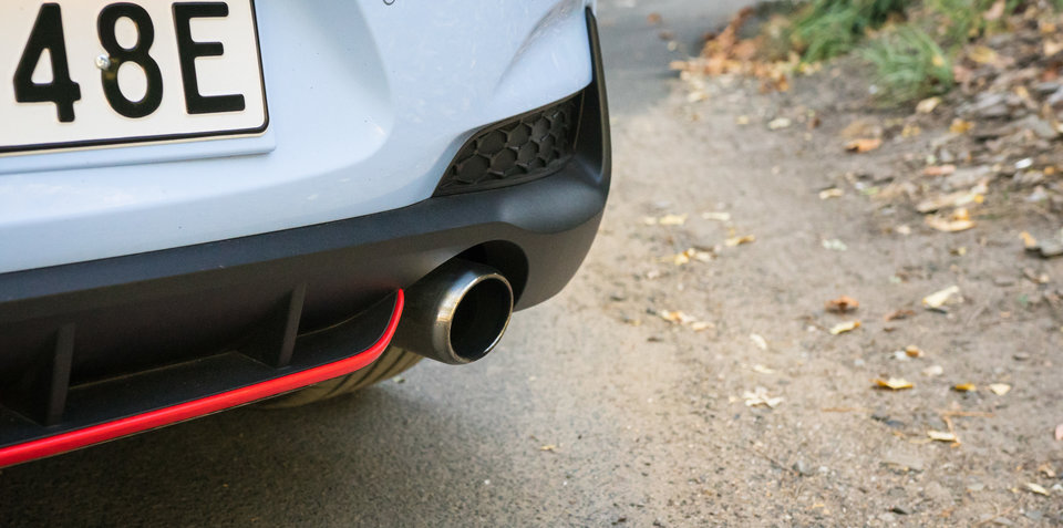 What causes exhaust snap, crackle and pop?