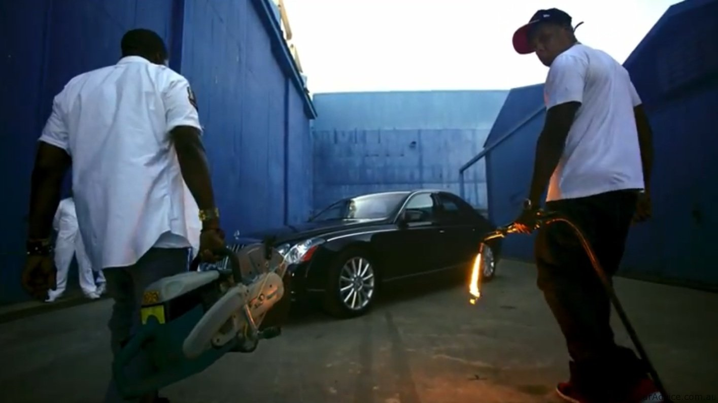 Jay Z And Kanye West Destroy Maybach In Otis Film Clip