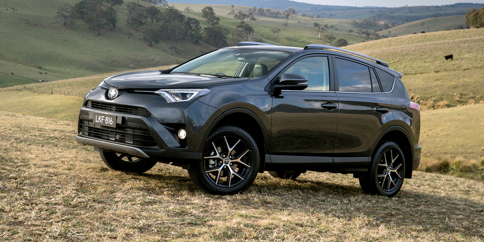 2018 toyota rav4 pricing and specs photos 1 of 9. Black Bedroom Furniture Sets. Home Design Ideas
